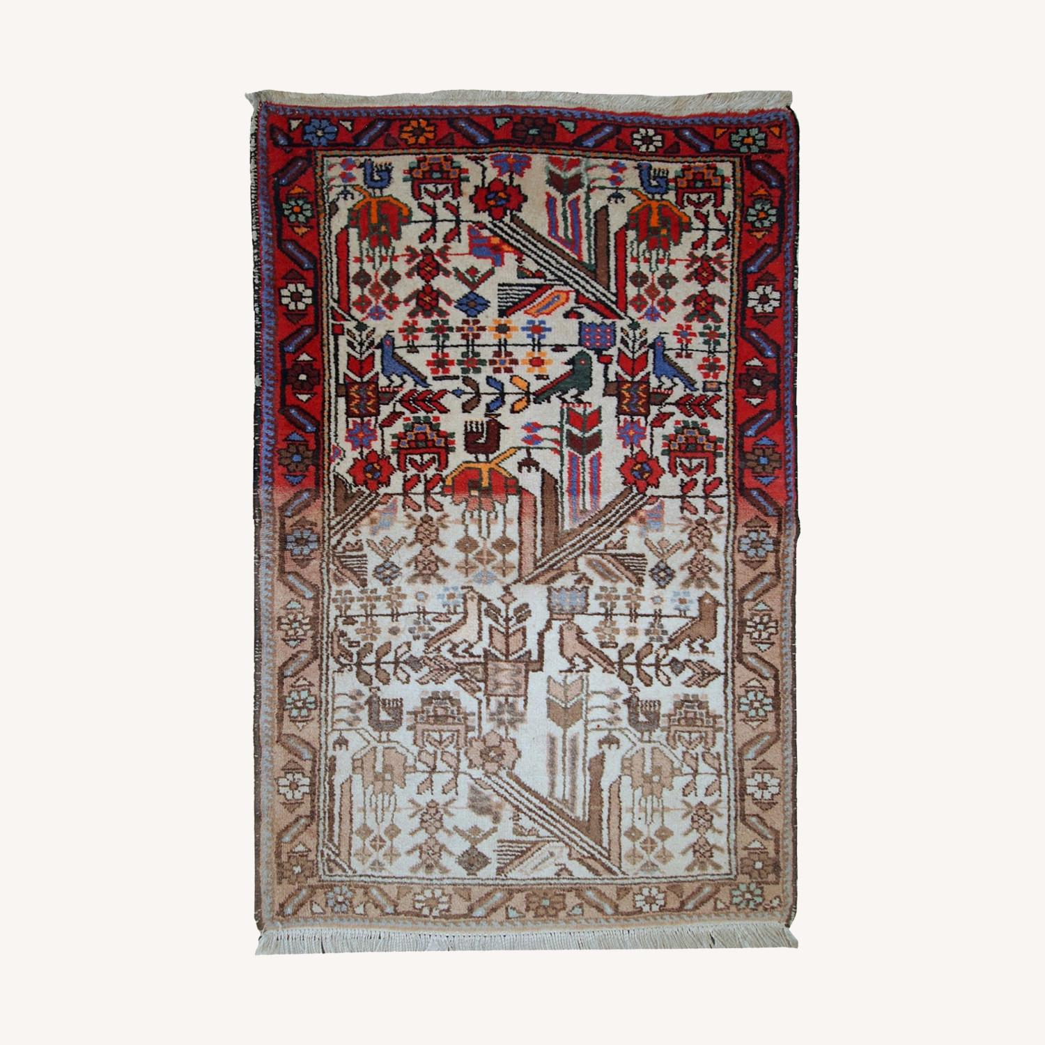 Handmade antique Persian Mashad rug - image-0