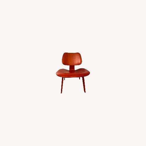 Used Eames Molded Plywood Lounge Chair (Red) for sale on AptDeco