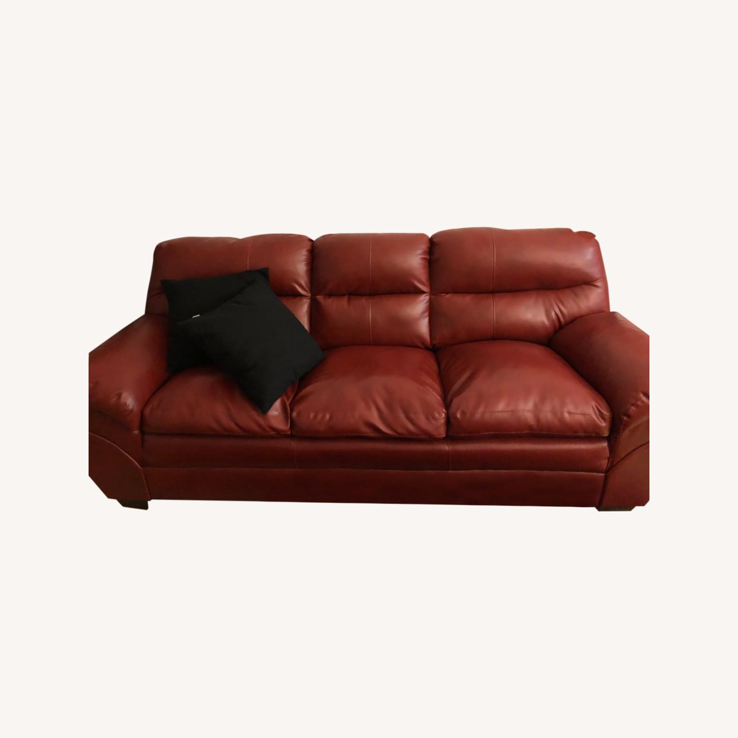 Claudio Rayes Red Couch - image-0