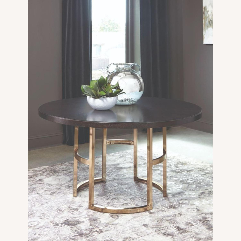Elegant Round Dining Table In Dark Brown - image-1