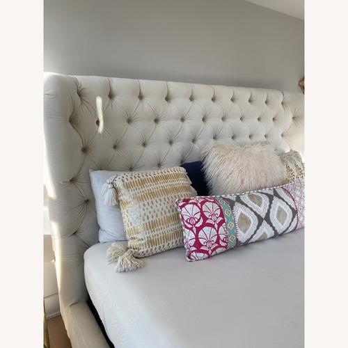 Used Anthropologie Velvet Tufted Wingback Bed for sale on AptDeco