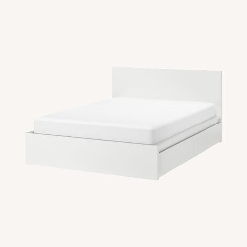 Used High Bed Frame/4 Storage Boxes for sale on AptDeco