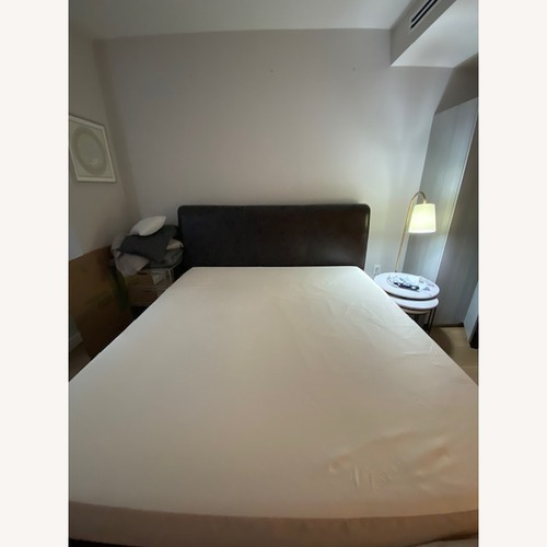 Used Charles P Rogers Leather & Wood Bed for sale on AptDeco