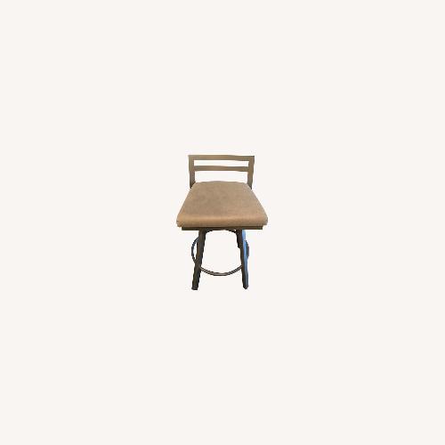 Used Urban Style Swivel Bar Stool with Cushion for sale on AptDeco