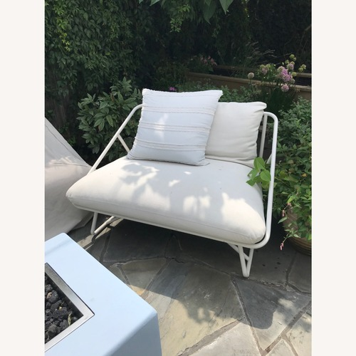 Used Pair of CB2 Oversize Outdoor Chairs w/ Covers for sale on AptDeco