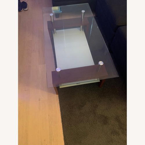Used Modern Double Shelf Coffee Table w/ Metal Frame for sale on AptDeco