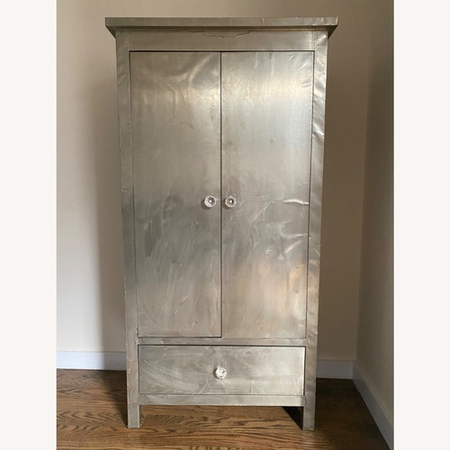 Used ABC Furniture Mirrored Armoire for sale on AptDeco