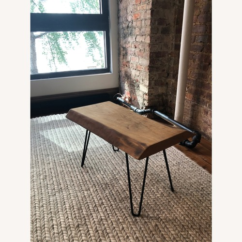 Used Walnut Slab Coffee Table with Cast Iron Legs for sale on AptDeco