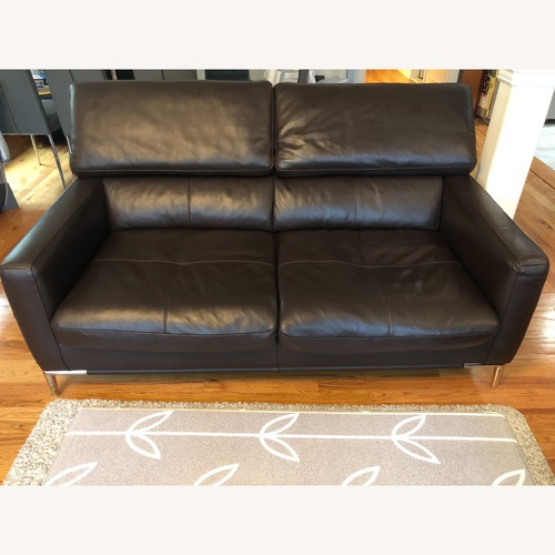 Used Dark Brown Leather Loveseat and Ottoman for sale on AptDeco