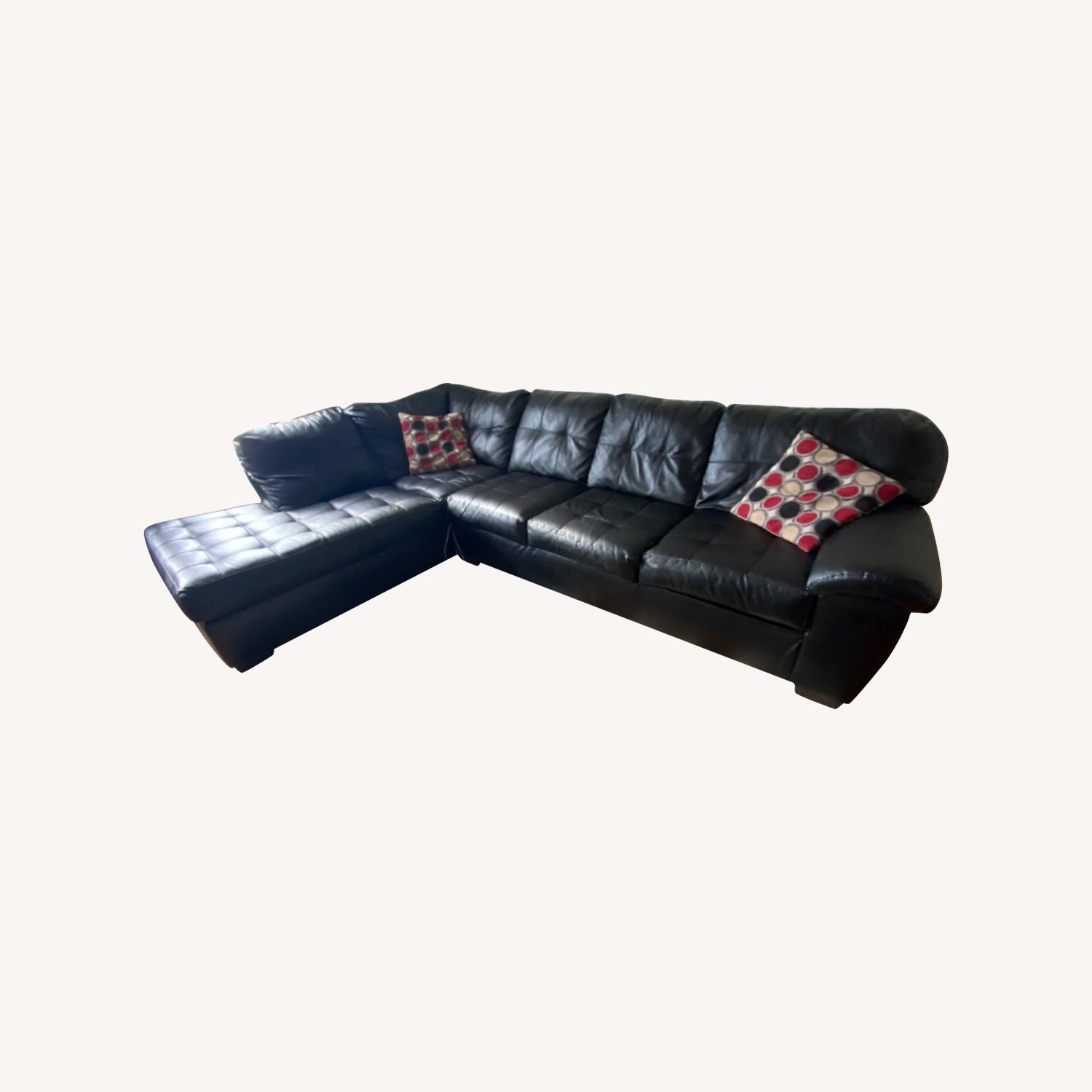 Bob's Discount Black Leather Couch - image-0