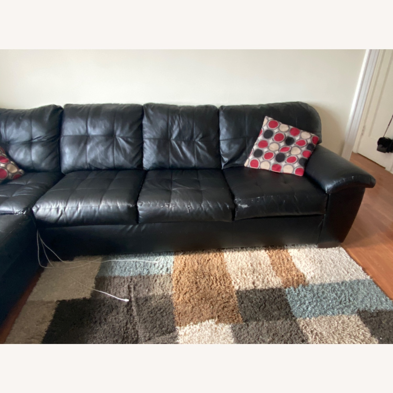 Bob's Discount Black Leather Couch - image-2