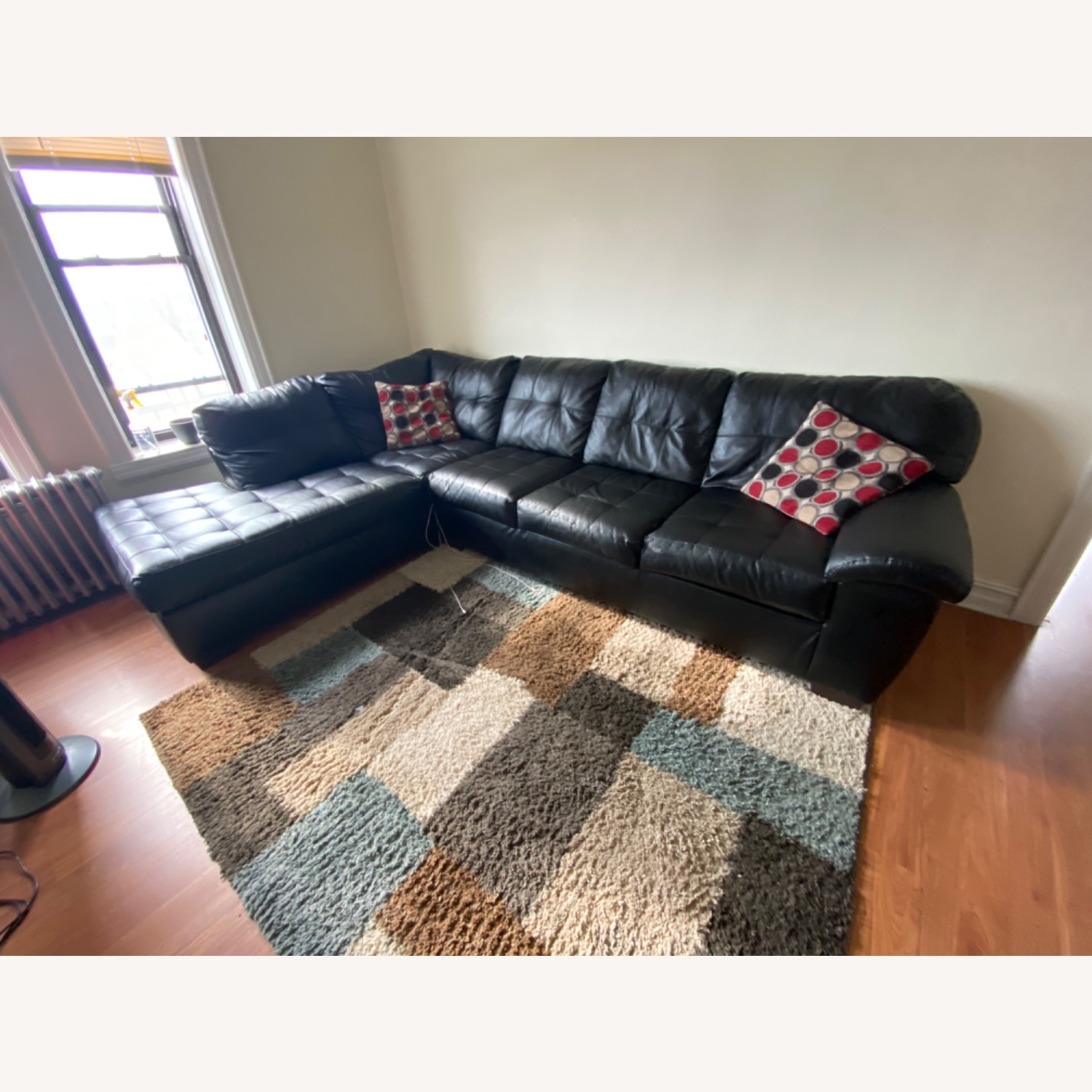 Bob's Discount Black Leather Couch - image-1