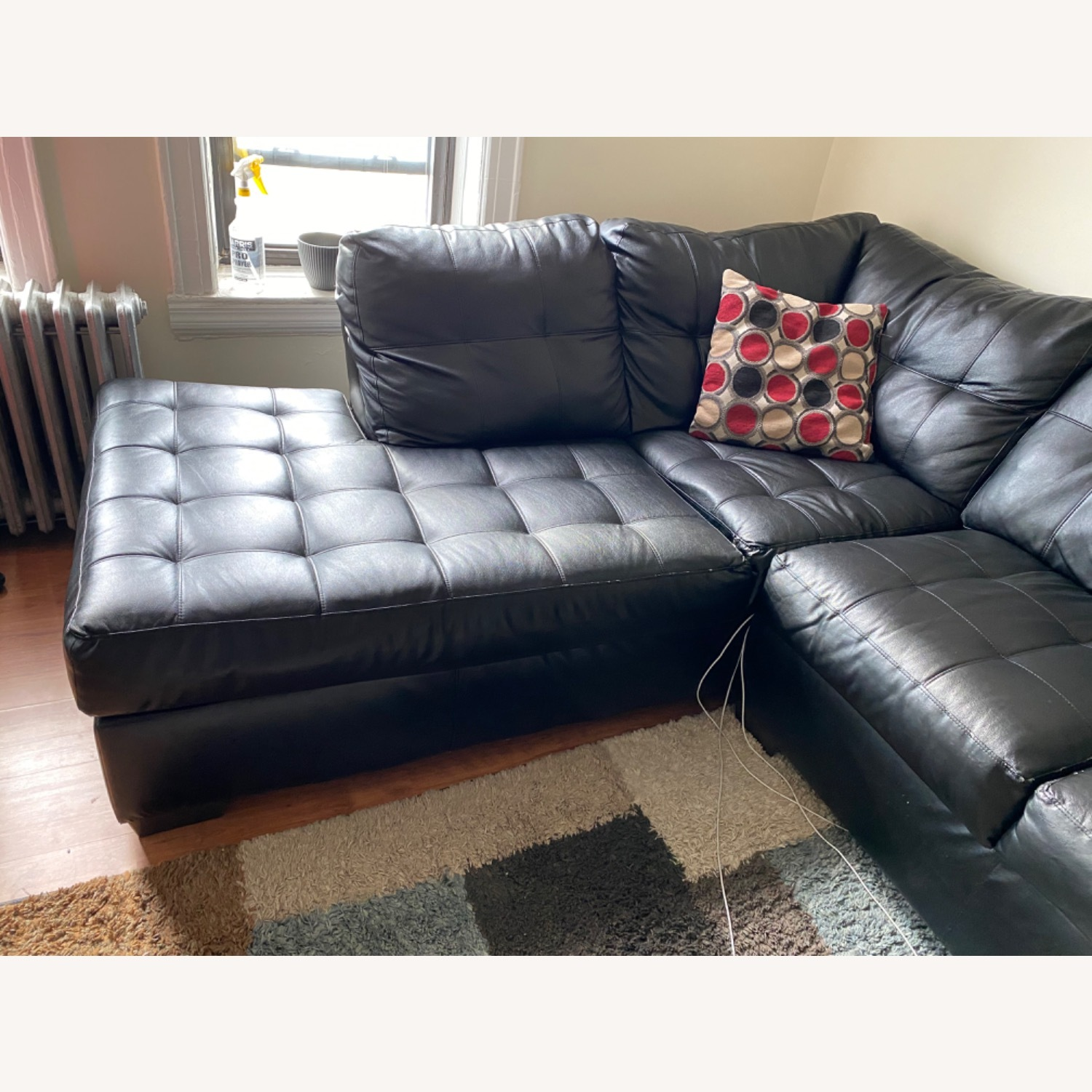 Bob's Discount Black Leather Couch - image-3