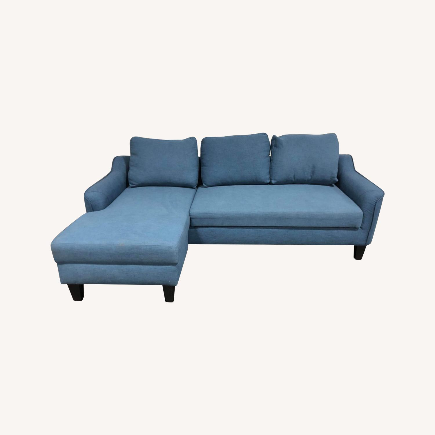Picture of: Ashley Furniture Jarreau Blue Sofa Chaise Sleeper Aptdeco