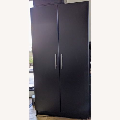 Used Prepac Manufacturing Black Wardrobe Storage Cabinet for sale on AptDeco