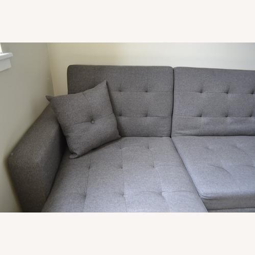 Used Mercury Row Nuttall Reversible Sleeper Sectional for sale on AptDeco
