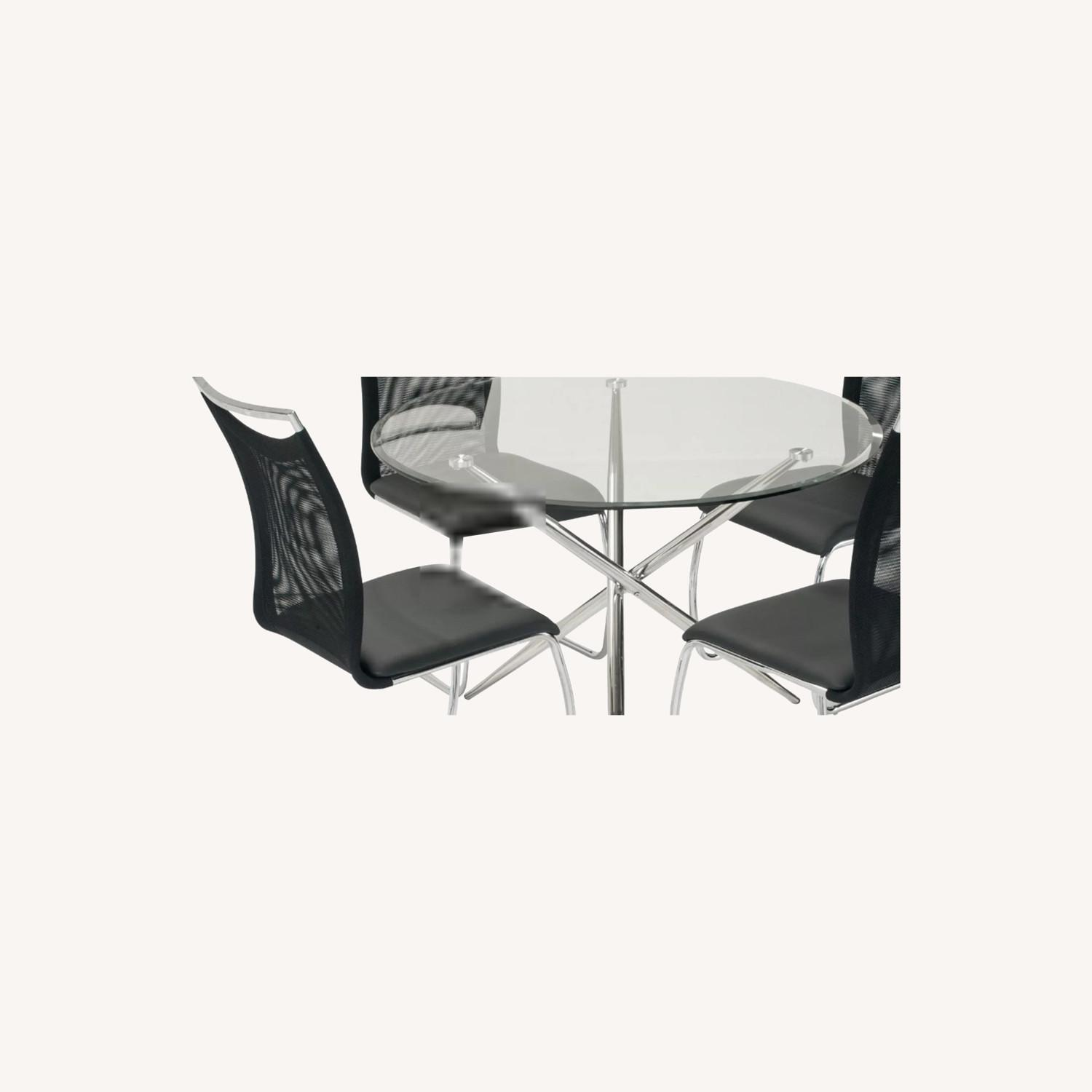 Raymour & Flanigan Glass Circular Table - 4 Chairs - image-0