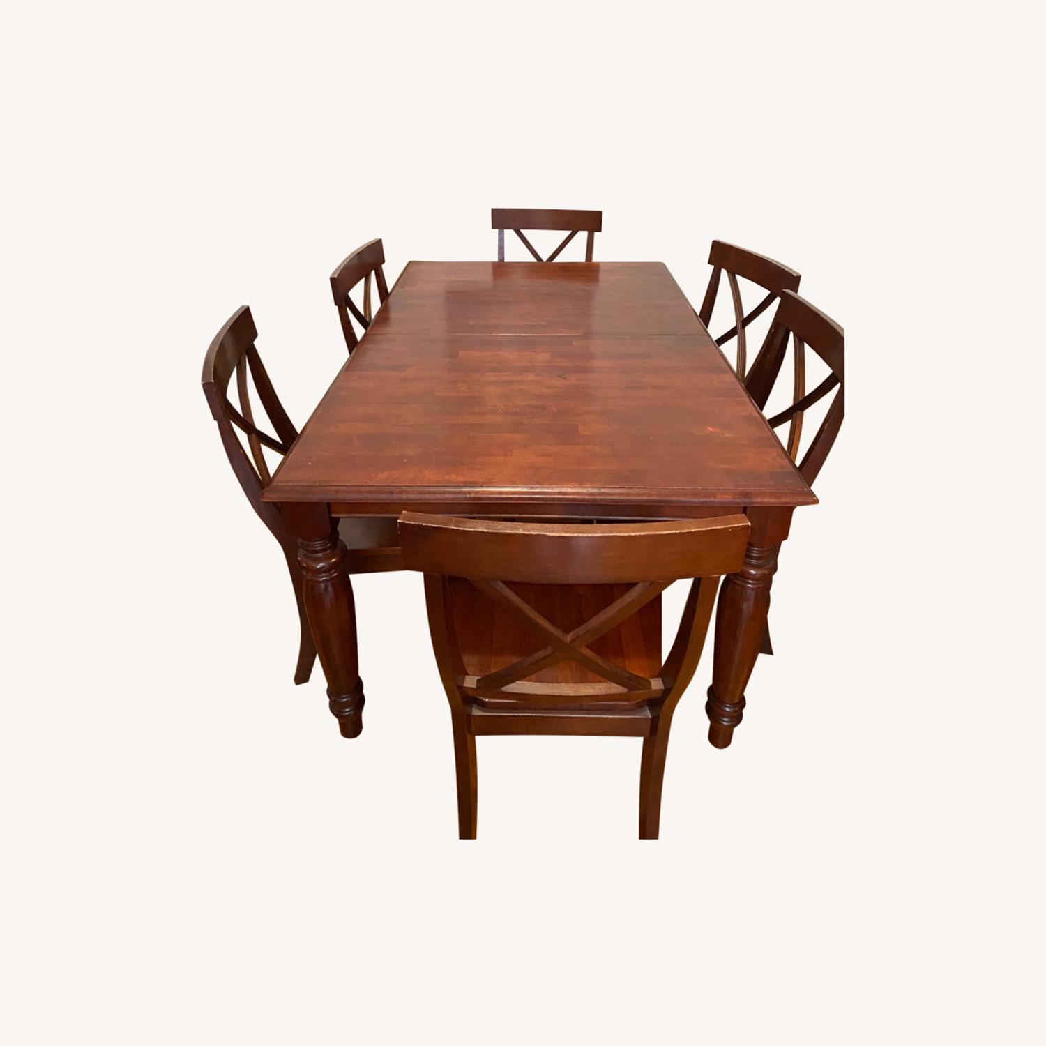 Pier One Imports Dining Set with Hidden Leaf - image-0