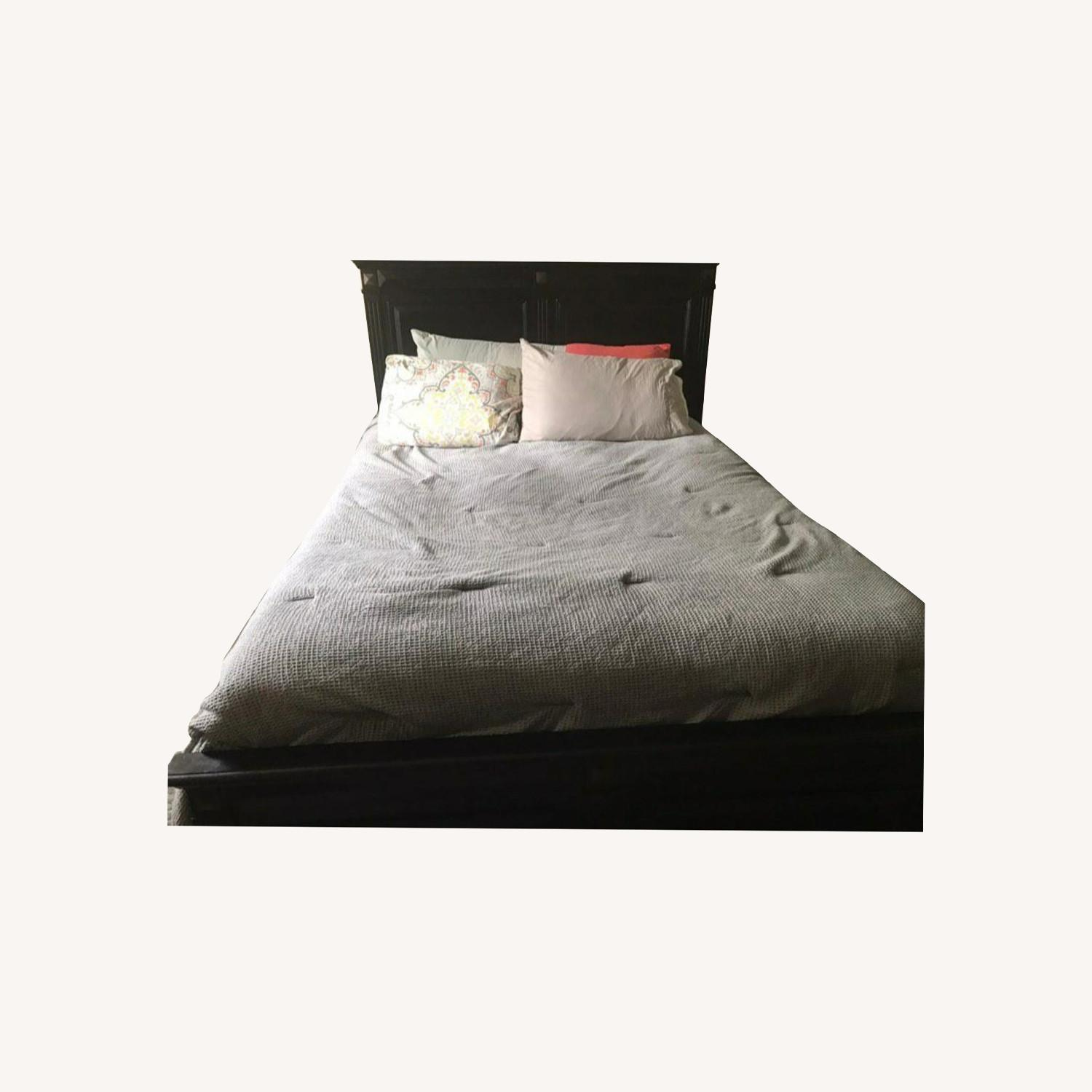 Dark Wood Queen Sized Bed - image-0