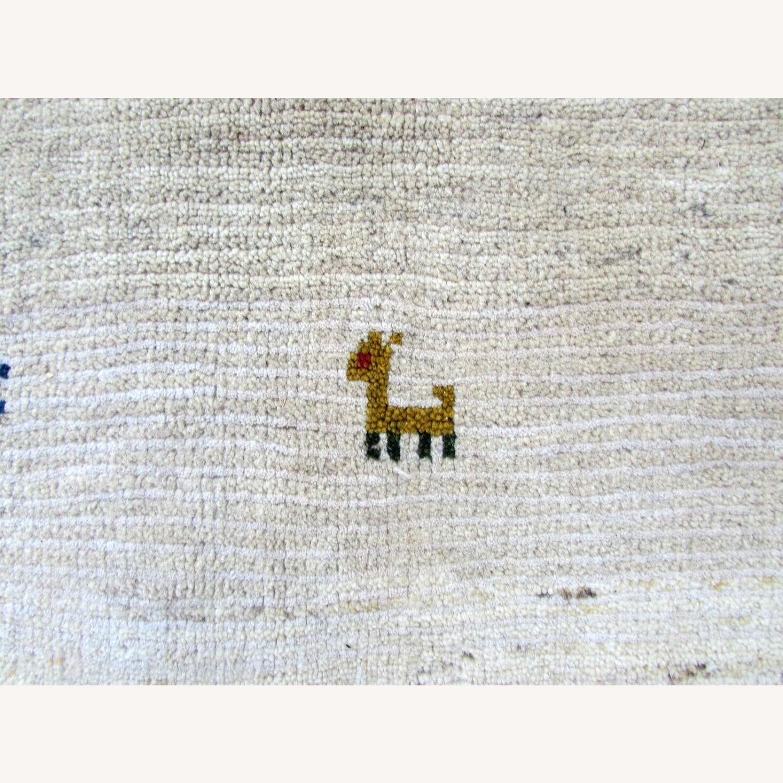 Handmade vintage Persian Gabbeh rug - image-1