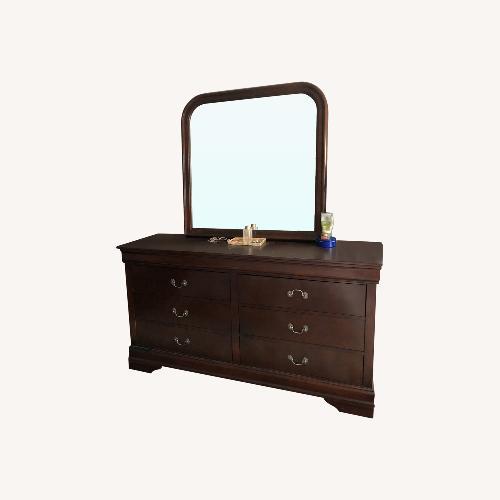 Used Art Van Wooden Dresser with Mirror for sale on AptDeco