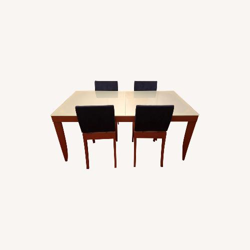 Used Ligne Roset Extendable Glass/Wood Table + 5 Chairs for sale on AptDeco