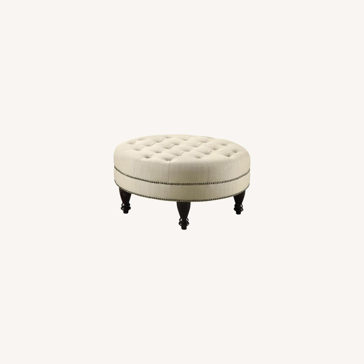 Round Ottoman In Linen-Like Oatmeal Fabric - image-3