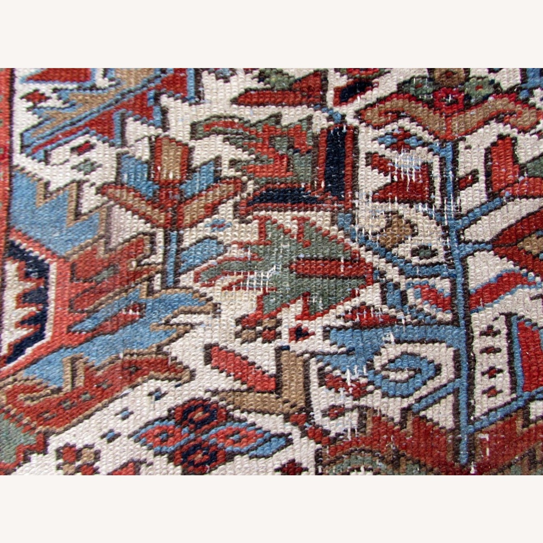 Handmade antique Persian Heriz distressed rug - image-10