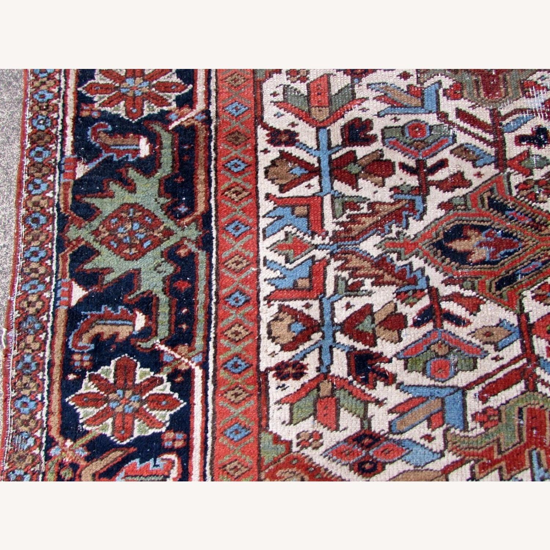 Handmade antique Persian Heriz distressed rug - image-11