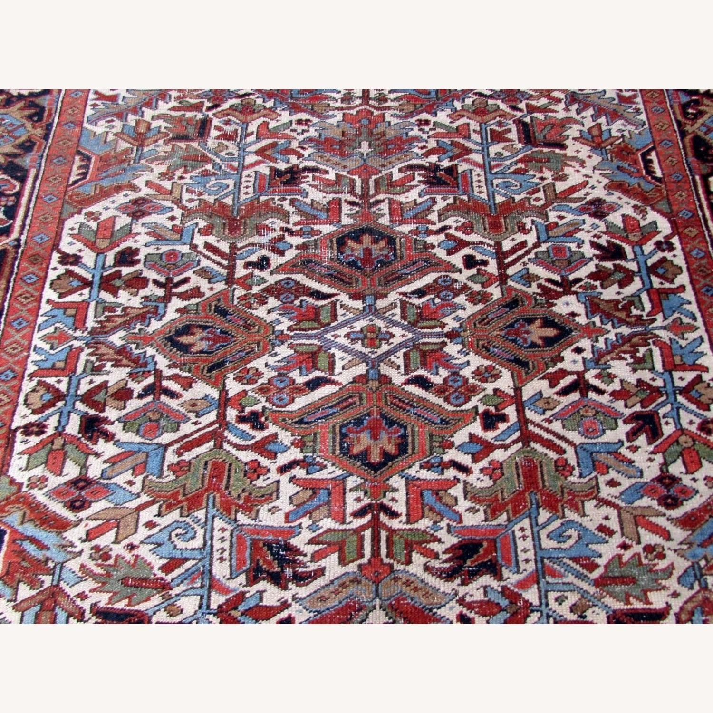 Handmade antique Persian Heriz distressed rug - image-4