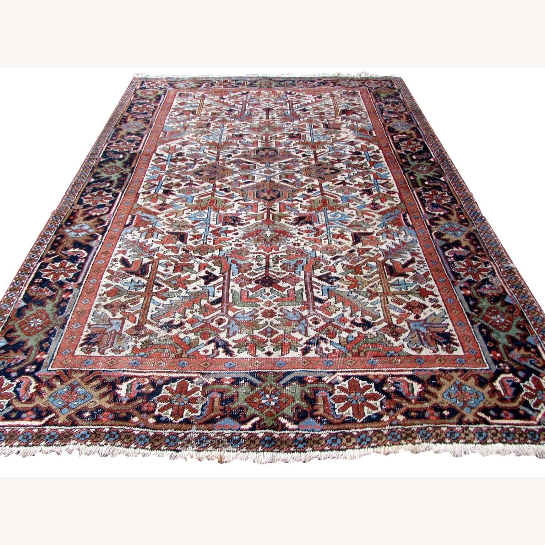 Handmade antique Persian Heriz distressed rug - image-1