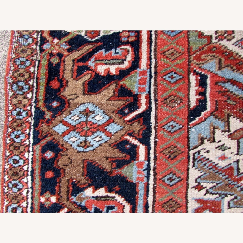 Handmade antique Persian Heriz distressed rug - image-12