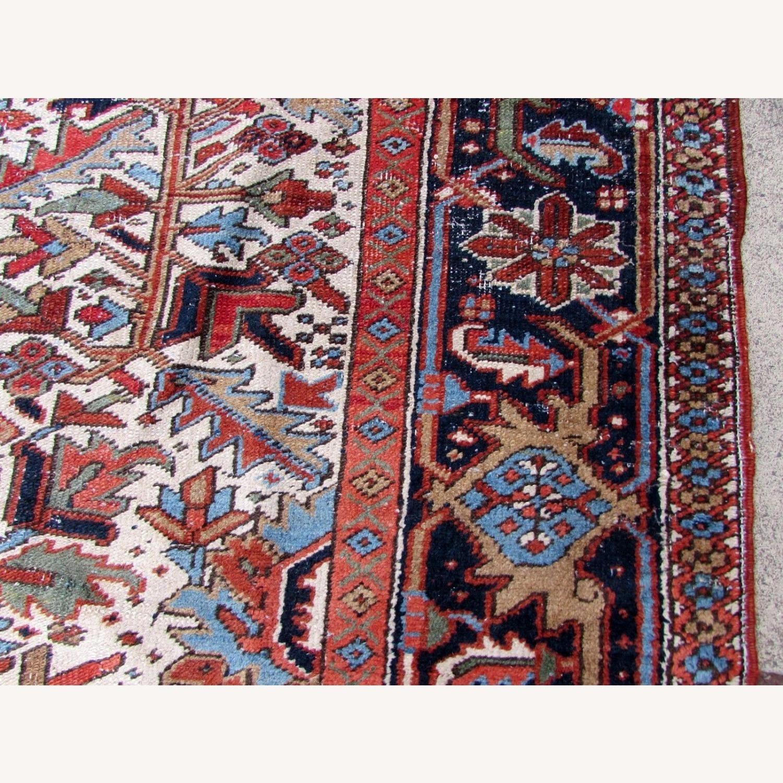 Handmade antique Persian Heriz distressed rug - image-7