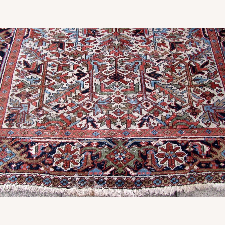 Handmade antique Persian Heriz distressed rug - image-5