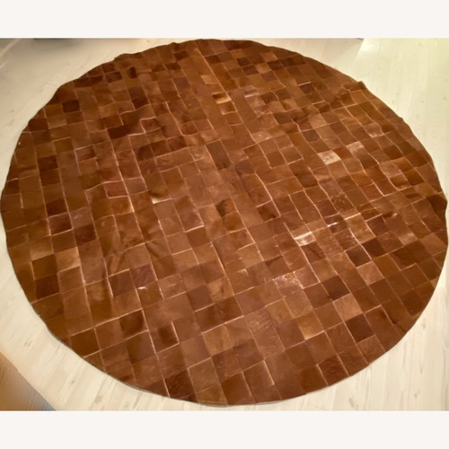 Used ABC Carpet and Home Cow Hide Patch Rug for sale on AptDeco