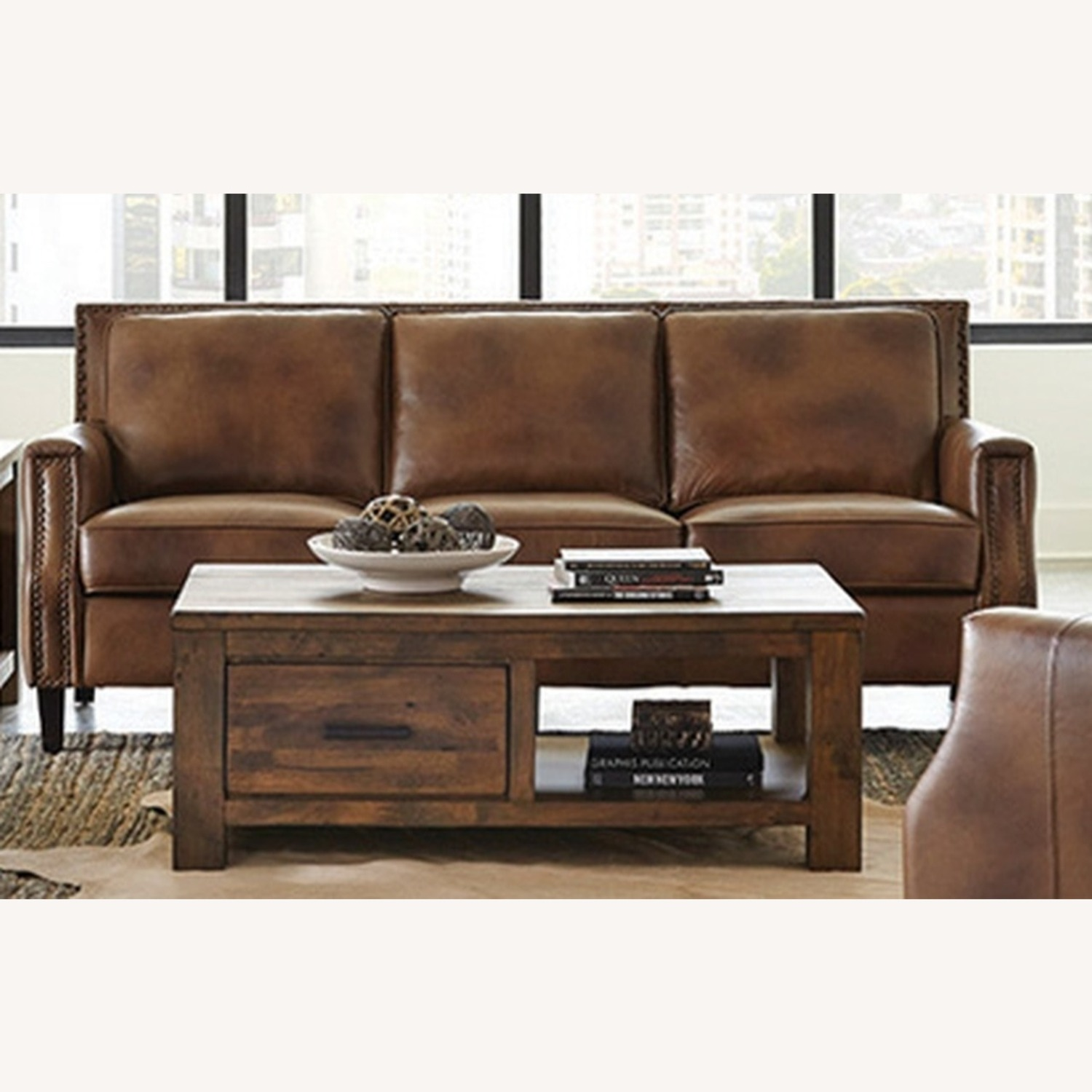 Sofa In Brown Leather Upholstery - image-0
