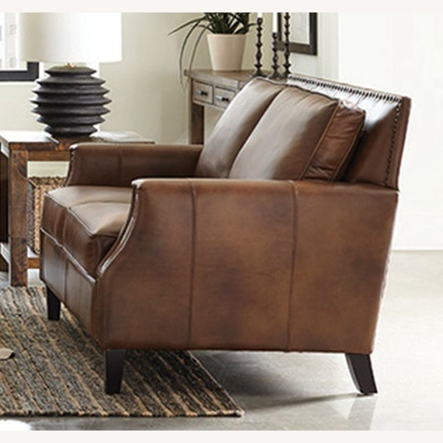 Loveseat In Brown Sugar Leather Upholstery - image-1