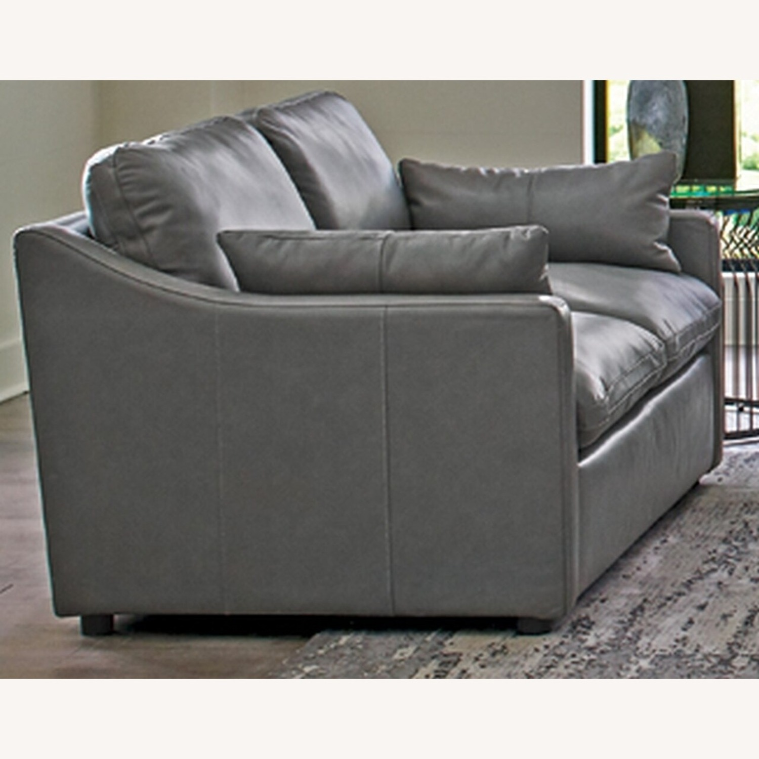 Loveseat In Grey Leatherette Upholstery - image-0