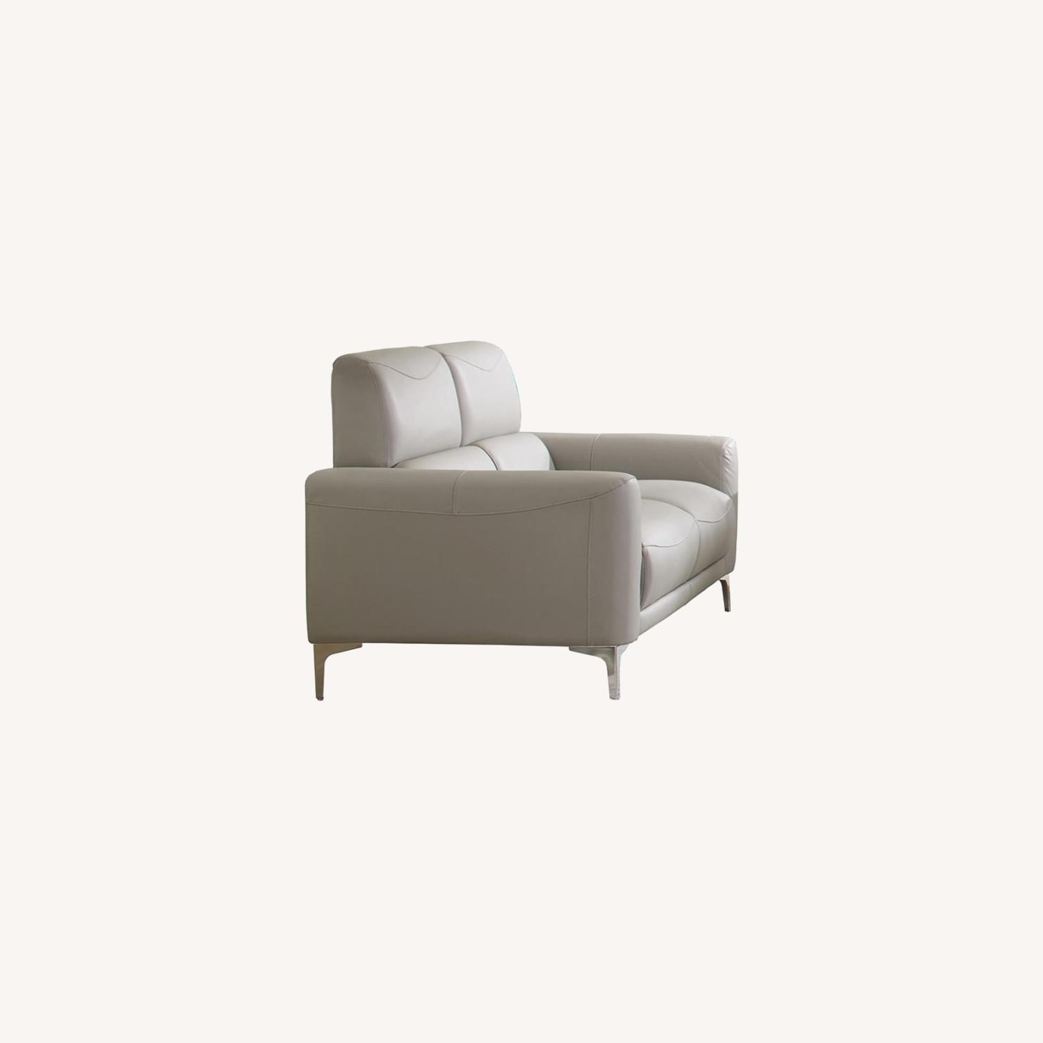 Loveseat In Soft Taupe Leatherette Upholstery - image-4