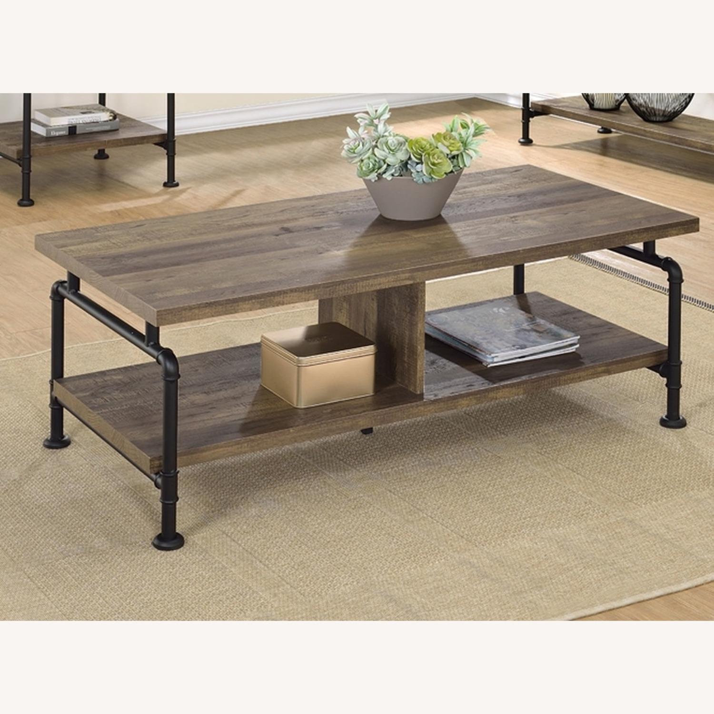 Coffee Table In Rustic Oak W/ Metal Pipe Legs - image-1