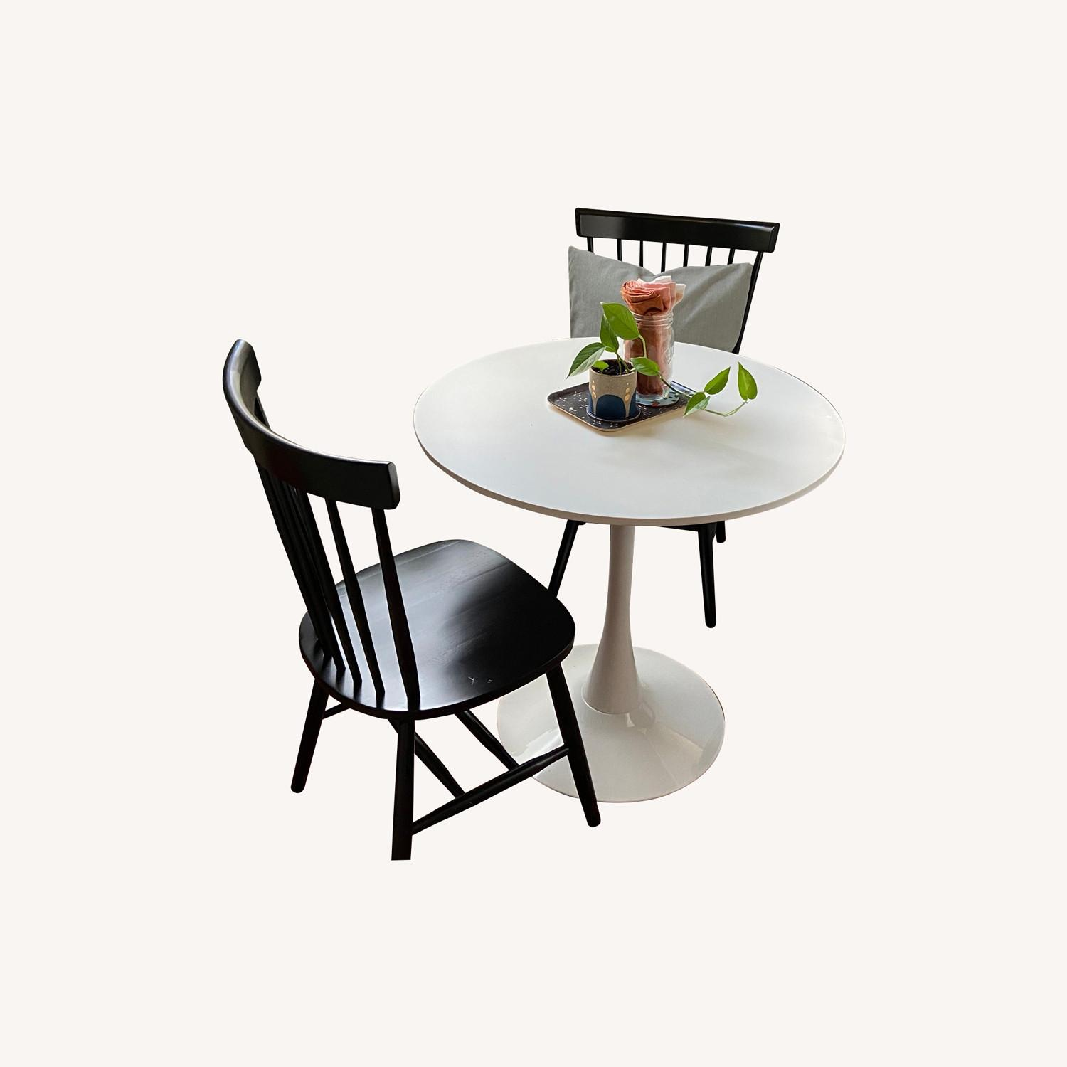 White Dining Table and 2 Black Spindle Chairs - image-0