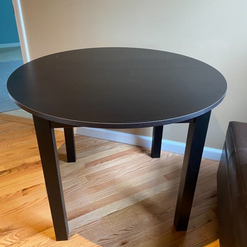 Used IKEA Dark Brown Round Dining Kitchen Table for sale on AptDeco