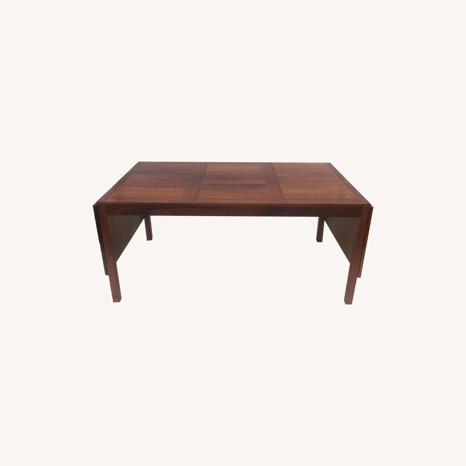Mid-Century Rosewood Dining Table With Leaves - image-0