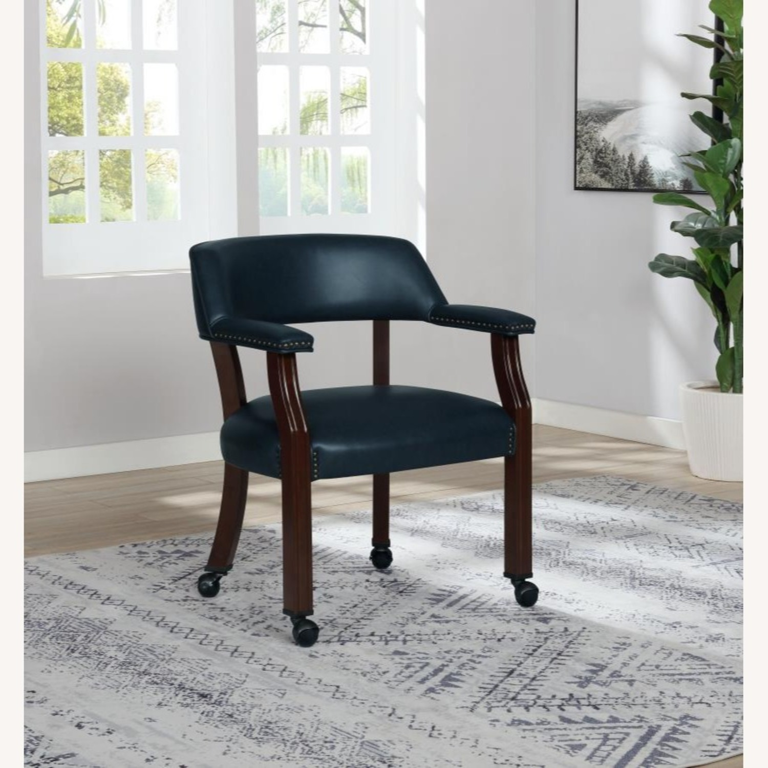 Guest Chair In Blue Leather W/ Wheeled Legs - image-2