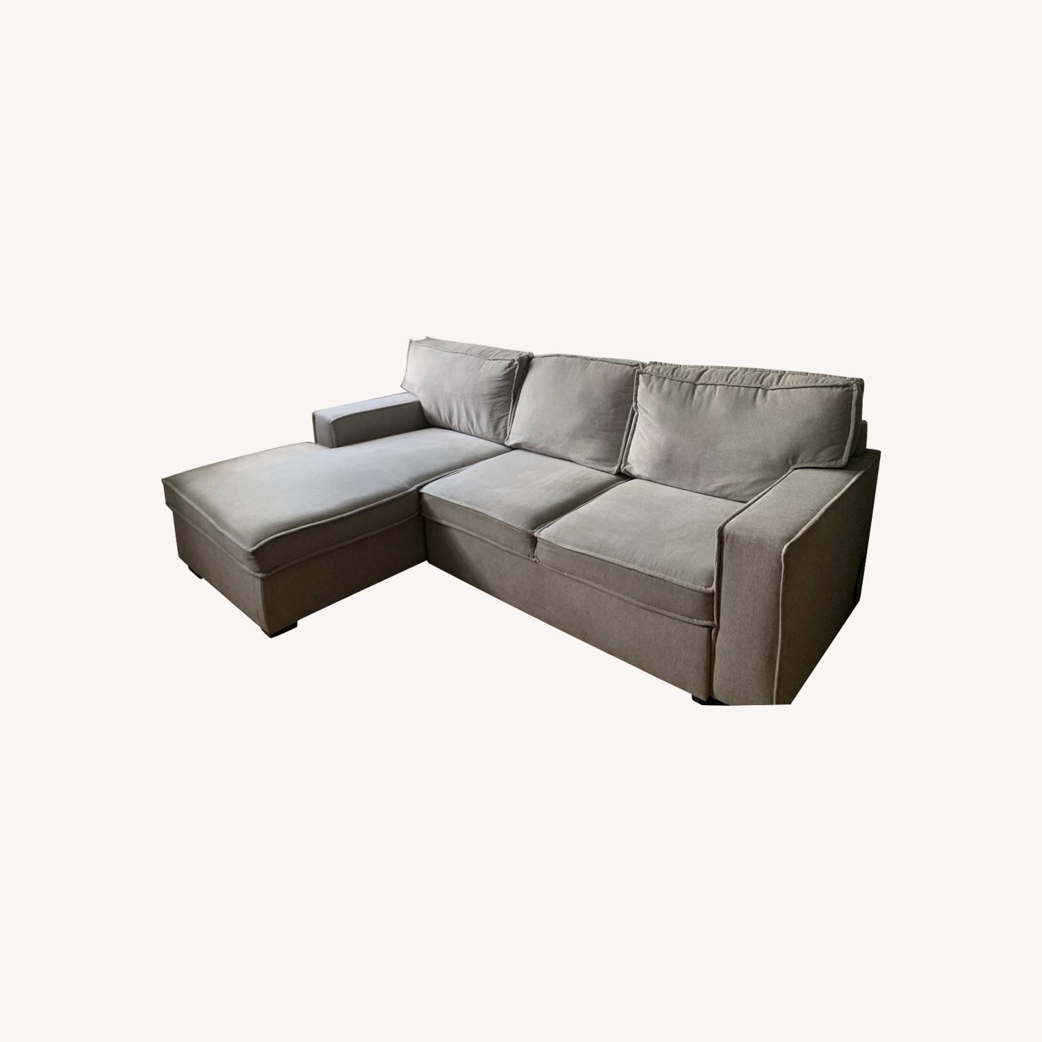 Bob's Track Arm Sectional with Pop-Up Sleeper - image-0