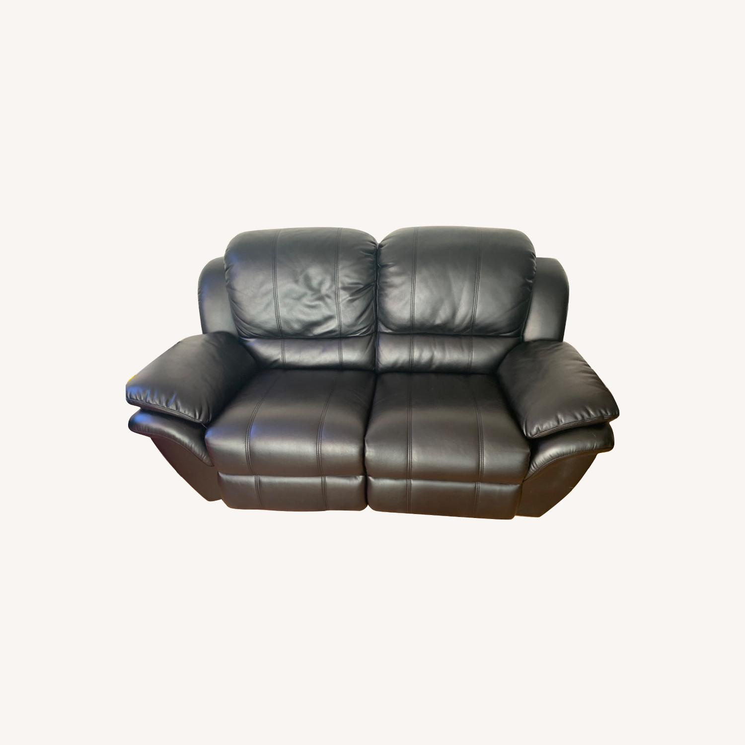 Bobs Black Leather Automatic Recliner Loveseat - image-0