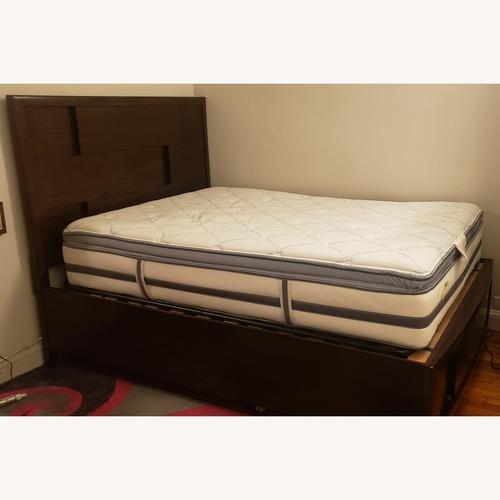Used Raymour & Flanigan Mahogany Full Bed w/ Storage for sale on AptDeco