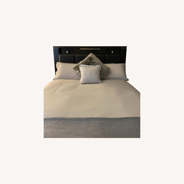 Bob's Discount Furniture Queen Bed with Storage Below - image-0