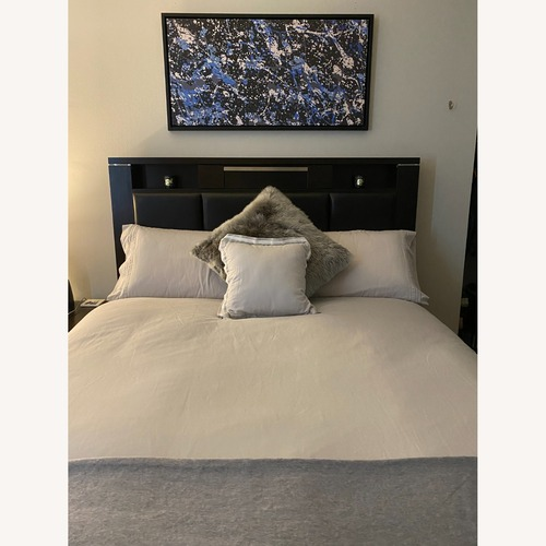 Used Bob's Discount Furniture Queen Bed with Storage Below for sale on AptDeco