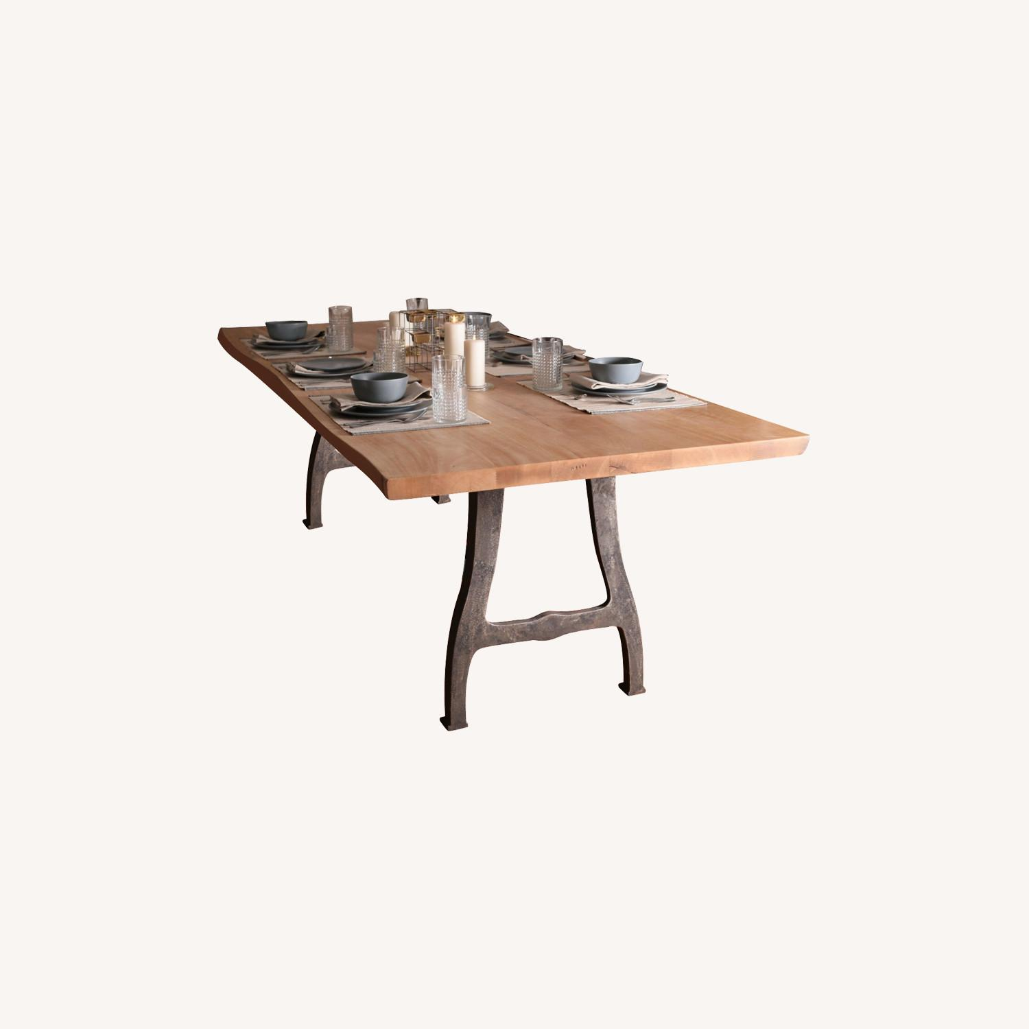 Picture of: Solid Exotic Wood Dining Table With Cast Iron Legs Aptdeco